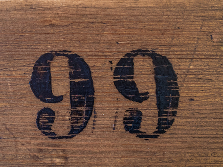 Number 99 on wooden surface Imagens