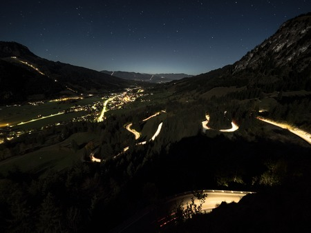 Switchbacks at the city Bad Hindeland in Germany at night illuminated by car lights