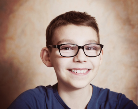 shortsightedness: handsome preteen boy with correction myopia glasses Stock Photo
