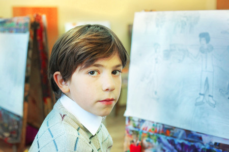 pre adolescent boys: handsome preteen boy at the art school lesson