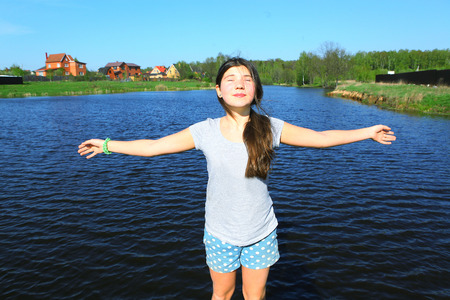 pool preteen: teenager beautiful girl on the country summer lake background
