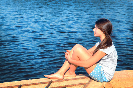water pool: teenager beautiful girl on the country summer lake background