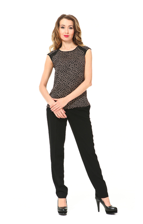 beautiful young business woman in office clothes printed sleeveless  blouse, black trousers and black high heel shoes