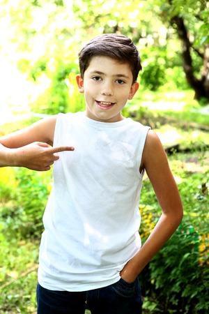 child model: preteen handsome boy in white tshirt free of inscription Stock Photo