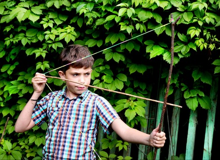 schlagbaum: boy with   turnpike aiming to the target