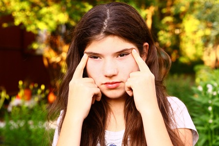 teen girl  with myopia try to see something far away Stock Photo