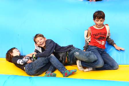 indoors: boys play on trampoline in summer amusement outdoor park