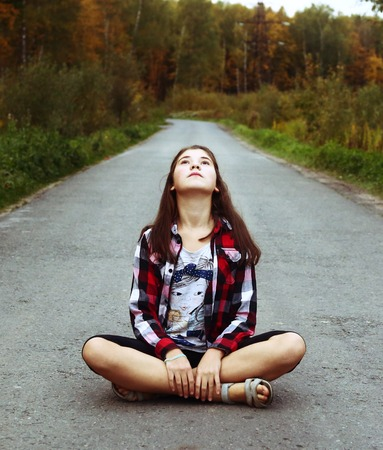beautiful teen: beautiful  teen girl sit on the country empty road
