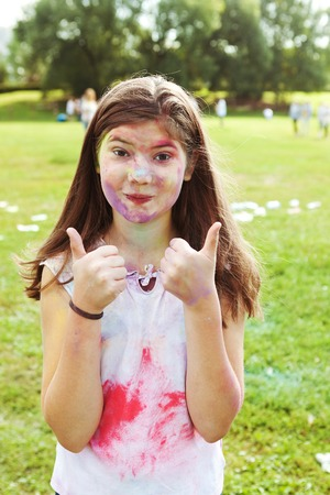 asian preteen: beautiful preteen girl portrain participating  in indian color holi fest