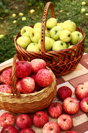 fresh   ripe red cut apples in basket on the table
