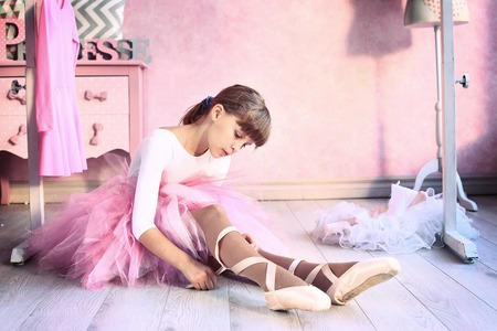pretty pony: teen little  girl prepare for classical dance lesson Stock Photo