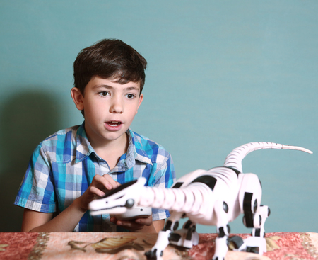 child model: preteen boy play with modern toy with remote control dragon Stock Photo