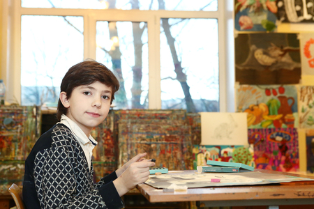 prodigy: MOSCOW, DECEMBER  24, 2015: Unidentified art school student boy participate in final  painting exhibition at the end of school trimester in Russia Moscow, December 24, 2015