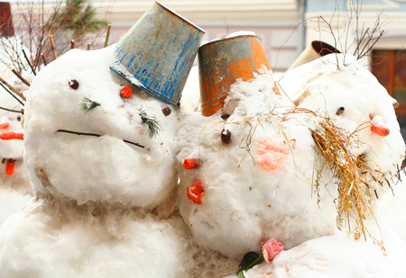artistry: group of snowman in the  winter outdoors in nothern city