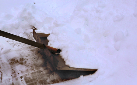 shovel clean snow from open air  ice rink surface Stock Photo