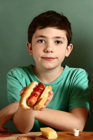 young boys: preteen handsome boy  with hot dog happy smiling close up portrai
