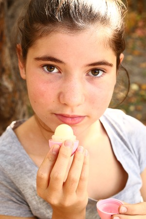 teen girl close up portrait with lip gloss Stock Photo