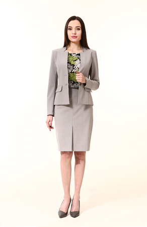 straight jacket: arabian  business executive woman with straight hair style in official two pieces  skirt jacket suit high heels shoes stand full body length isolated on white
