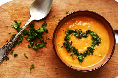 carotid: pumpkin smashed soup  with parsley dill heart Stock Photo