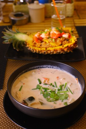 notional: thai food restaurant stuffed with rise shrimps prawn raisin fruit pineapple close up photo on the table