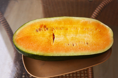 watery: yellow water melon cut on the plate served for dietary dessert