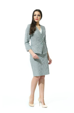 straight jacket: eastern  woman with straight pony tail hair style in official jacket skirt suit high heel shoes going full body length isolated on white
