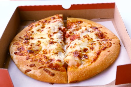 fatter: Pizza in cardboard box close up photo Stock Photo