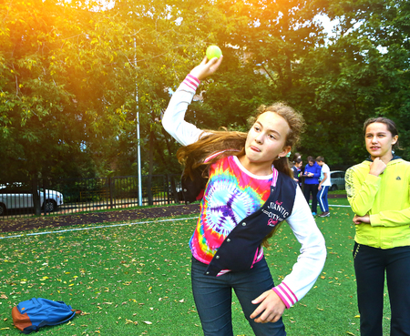 MOSCOW, RUSSIA, SEPTEMBER 13, 2016: Unidentified school kids on outdoor sport throwing ball competition in school yard in Moscow, September 13, 2016