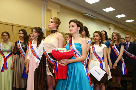 graduation party: Moscow, Russia - June 24, 2016: Unidentified school pupils in formal dress and suit greeting their teachers in solemn graduation party festive day.