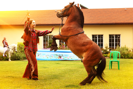 perfomance: cowboy perfomance with the horse at the private kids party Stock Photo