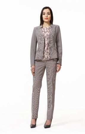 indian business woman with straight hair style in official gray pant suit high heel shoes full body length isolated on white Stock Photo