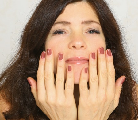 cupper: pretty woman with manicure close up photo