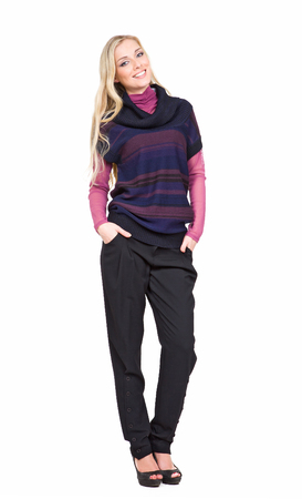 blond european business executive woman with straight hair style in knitted woolen sweater casual trousers high heels shoes stand full body length isolated on white