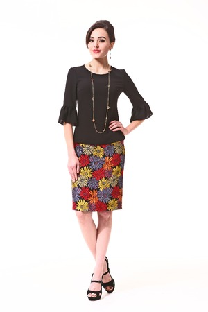 Asian Woman With Up Do Hair Style In Patchwork Skirt And Black Blouse High Heels Shoes