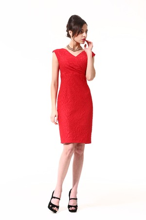 decolette: woman with updo hair style in fokrmal party red decolette dress high heels shoes full length body portrait standing isolated on white