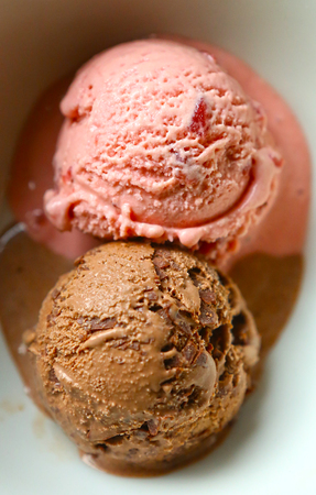 peppermint cream: Two rounded single servings of delicious chocolate and strawberry flavored ice cream decorated with peppermint