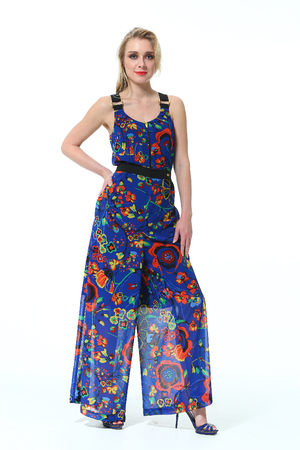 blue overall: woman with straight hair style in summer blue floral print overall high heels shoes full length body portrait standing isolated on white Stock Photo
