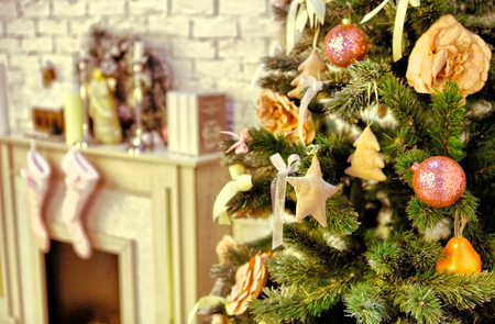 decorated tree: christmas decorated tree with presents fire place and socks Stock Photo