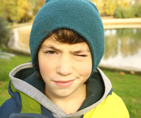 preteen handsome boy outdoor autumn portrait in the park close up Stock Photo