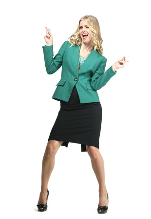 woman with straight hair style in green power suit high heels shoes full length body portrait grimacing acting smiling gesturing isolated on white Stock Photo