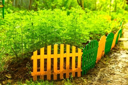 pitchfork: decorative plastic fence border in the summer garden