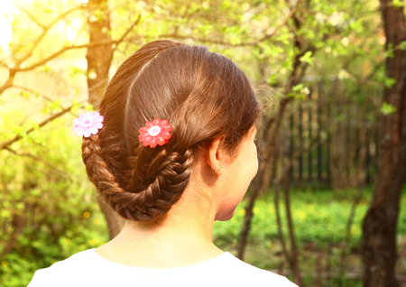 teen girl plaited hair style with country fashion variation close up back photo Stock Photo