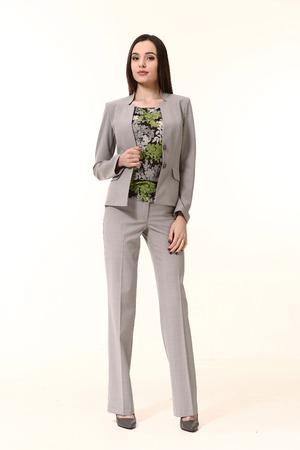 straight jacket: woman straight hair style in two pieces jacket and trousers power pant suit high heels shoes full length body portrait standing isolated on white Stock Photo