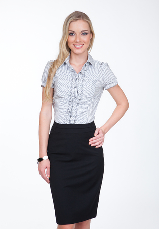 pretty young manager blond woman in pencil black skirt and short sleeve official shirt close up smiling photo isolated on white Stock Photo
