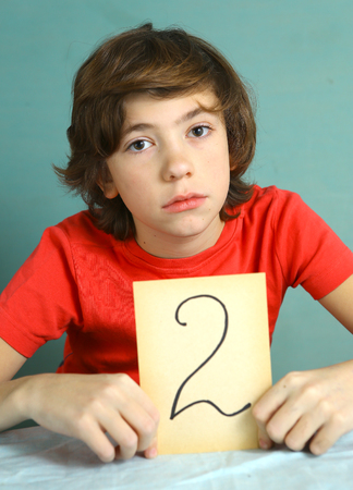 negatively: preteen boy with bad mark 2 close up photo sad and frustrate