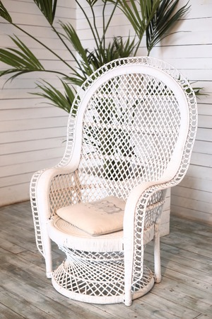 wicker white armchair in shabby chic close up photo Stock Photo