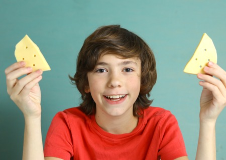 say cheese: say cheese smile preteen boy with two cheese slices close up photo with white strong teeth Stock Photo