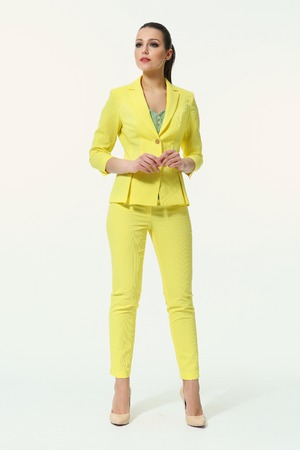 suit skirt: business woman with straight hair style in office yellow pant suit skirt suit high heel shoes going full body length isolated on white