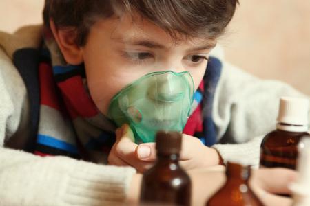 flue: boy with electric inhaler as a curation against virul disease flue