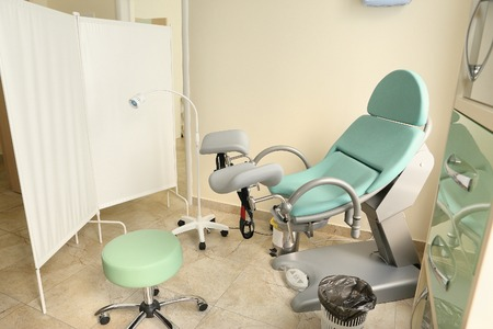 endometrial: gynecological cabinet interior with chair and screen